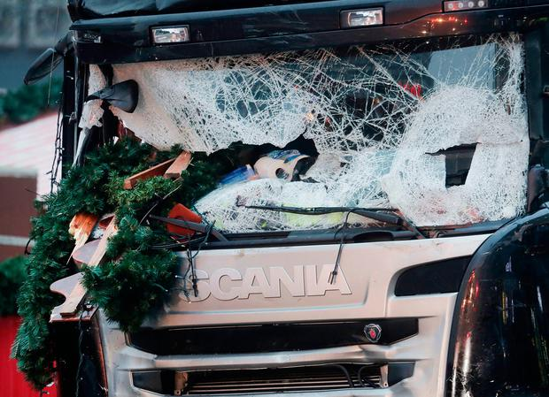 The smashed window of the cabin of a truck which ran into a crowded Christmas market Monday evening killing several people Monday evening is seen in Berlin, Germany, Tuesday, Dec. 20, 2016.(AP Photo/Markus Schreiber)