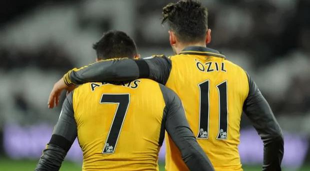 Alexis Sanchez and Mesut Ozil are demanding hugs wage increases CREDIT: GETTY IMAGES