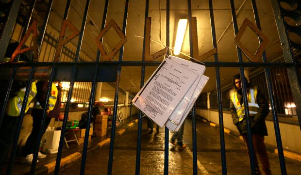 The High Court notice to vacate the building on the gates of Apollo House. Picture: Gerry Mooney