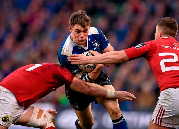 Garry Ringrose being tackled by two Munster players in April's derby; however, he may make way for Rory O'Loughlin in Monday's clash. Photo: Brendan Moran / Sportsfile