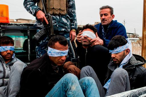 Christian militia fighters show four men believed to be members of Isil who were found inside a tunnel in the Iraqi city of Mosul. Photo: JM Lopez/AFP/Getty Images