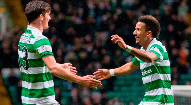 Celtic's Scott Sinclair celebrates scoring his side's first goal with Liam Henderson (right) Picture: PA