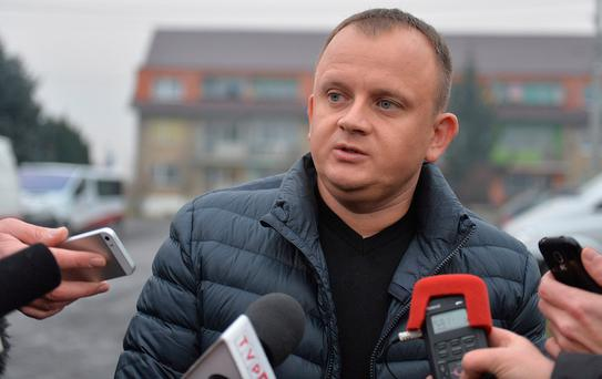 Ariel Zurawski, the owner of a Polish trucking company and cousin of Lukasz Urban, who was apparently the first victim of the attack in Berlin on Monday, speaks to reporters during a media conference in Sobiemysl, north-western Poland. (AP Photo)