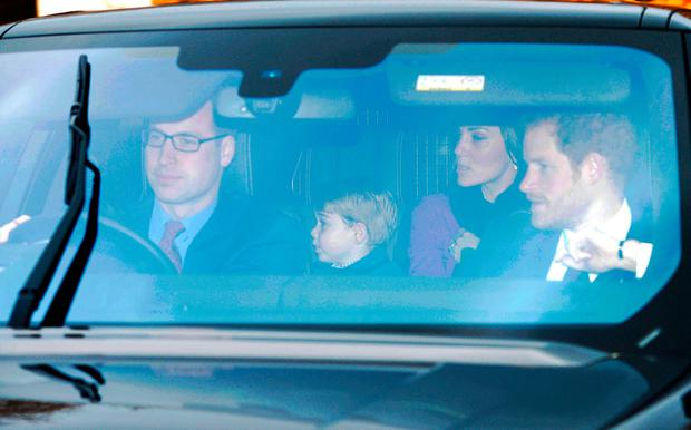 The Duke and Duchess of Cambridge, Prince Harry and Prince George arriving for the Queen's Christmas lunch at Buckingham Palace, London.