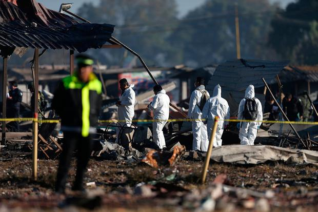 Investigators work among the wreckage following explosions at the San Pablito fireworks market Picture: Reuters