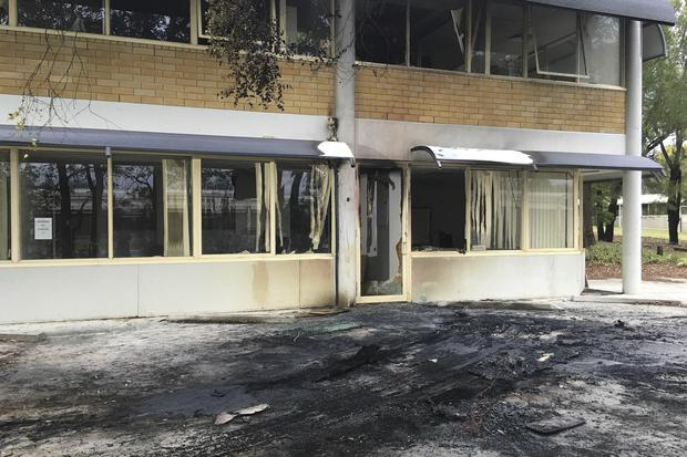 The damaged front of the Canberra office of the Australian Christian Lobby is seen in Canberra. (Belinda Merhab/AAP Image via AP)