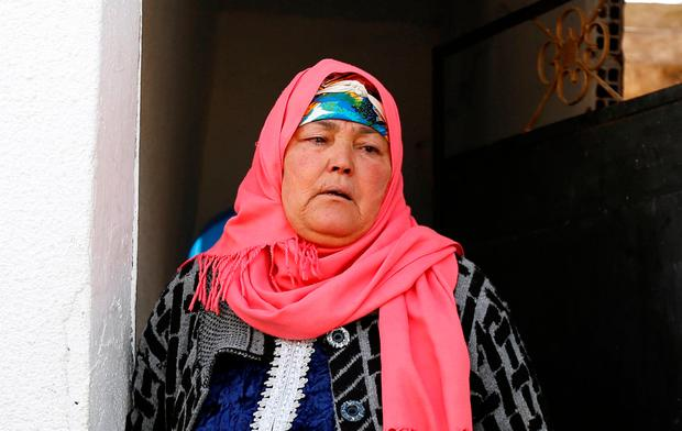 Nour, mother of suspect Anis Amri who is sought in relation with the truck attack on a Christmas market in Berlin, reacts near their home in Oueslatia, Tunisia December 22, 2016. REUTERS/Zoubeir Souissi
