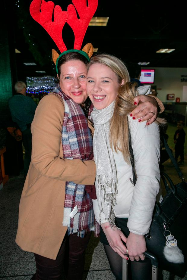 Mary Cahill greets her daughter Sarah at Shannon Airport as she arrives home from London
