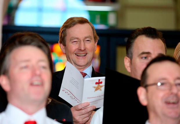 Enda Kenny takes part in the annual Christmas Carol concert held at Government Buildings. Photo: Tom Burke