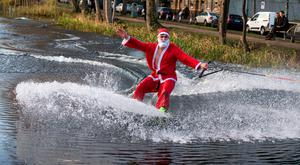David O'Caoimh raised eyebrows as he sped down the Grand Canal in Dublin dressed in a Santa suit on a wakeboard attached to a pulley powered by a generator. Photo: Mark Condren
