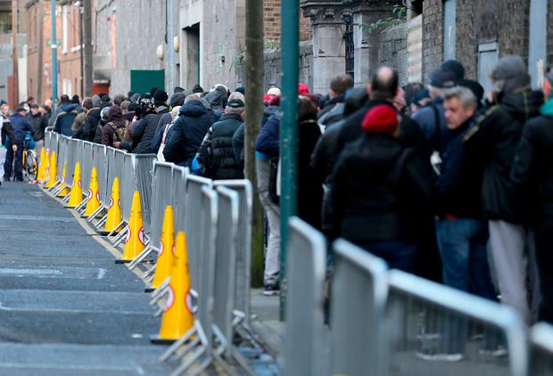 People queue for the parcels outside the Capuchin Centre. Photo: Gerry Mooney