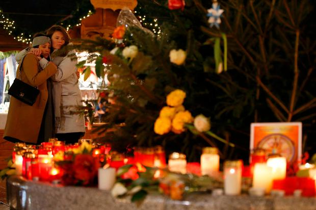 Candles and flowers have been placed at the scene of the Berlin Christmas market attack which left 12 people dead. Photo: Reuters/AP