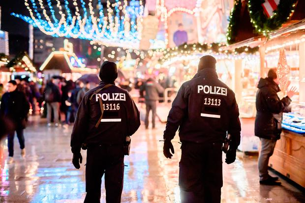 Police patrols at the reopened Christmas market near the Kaiser Wilhelm Memorial Church in Berlin. Photo: Clemens Bilan/Getty