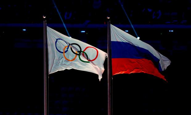 File photo dated 23-02-2014 of The Olympic flag flies next to the Russian flag during the Closing Ceremony at the Fisht Olympic Stadium, during the 2014 Sochi Olympic Games. PRESS ASSOCIATION Photo. Issue date: Friday December 23, 2016. Twenty-eight Russian athletes who competed at the Sochi Winter Olympics in 2014 are being investigated for the alleged