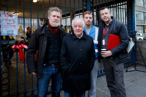 Glen Hansard, Jim Sheridan, Justin Casey and Brendan Ogle outside the Apollo House complex. Photo: Gerry Mooney