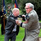 May 26, 2016: Ambassador Kevin Vickers wrestled with protester Brian Murphy (47) at Dublin 1916 Remembrance ceremony Photo: Tony Gavin