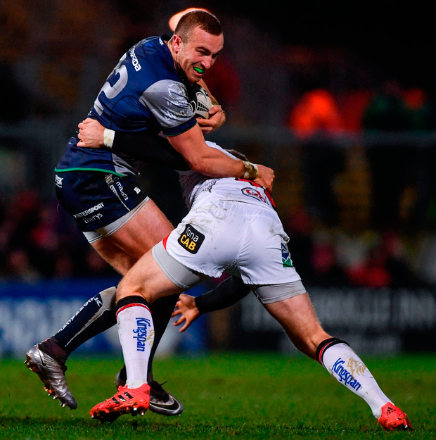 Connacht's Ciaran Gaffney battles through a tackle by Ulster's Darren Cave. Photo: Ramsey Cardy/Sportsfile