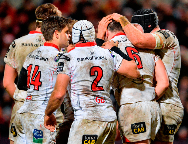 Ulster's Clive Ross, 6, is congratulated by his team-mates after scoring his side's second try at the Kingsman Stadium. Photo: Oliver McVeigh/Sportsfile