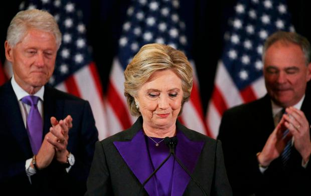 Hillary Clinton, accompanied by her husband, former US president Bill Clinton and running mate Senator Tim Kaine, concedes defeat to Donald Trump. Photo: Reuters