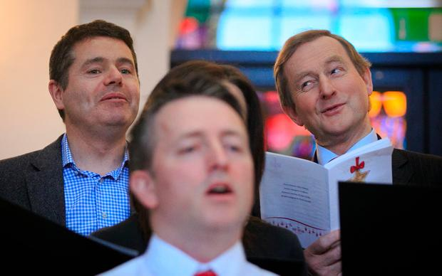 Taoiseach Enda Kenny and Public Expenditure Minister Paschal Donohoe during the annual recital by the Department of the Taoiseach staff choir. Photo: Collins