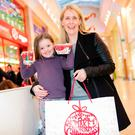 Left: Elizabeth Devane and her daughter Sarah (4) Christmas shopping at Marshes Shopping Centre in Dundalk. Photo: Arthur Carron