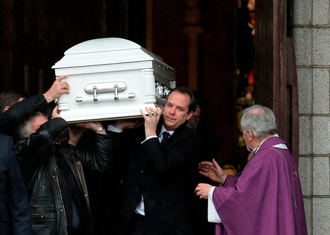 Shane O'Driscoll (right) carries the coffin of his son Oisín (7) in Bray, Co Wicklow Picture: Caroline Quinn