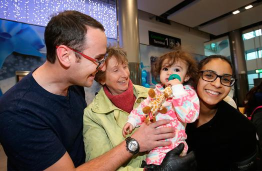 Left, Siobhan Delahunt (1) with her nana Isobel Delahunt after she arrived into Dublin airport with her parents, Alan and Janice, from Orlando Picture: Frank McGrath