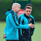 Arsene Wenger has defended Mesut Ozil's recent performances. Photo: Olly Greenwood/Getty Images