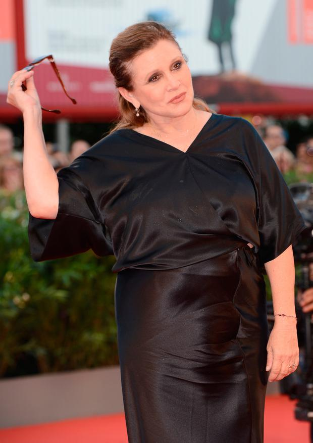 Jury member Carrie Fisher attends the Opening Ceremony And 'Gravity' Premiere during the 70th Venice International Film Festival at the Palazzo del Cinema on August 28, 2013 in Venice, Italy. (Photo by Ian Gavan/Getty Images)