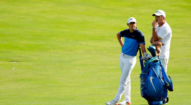 Rory McIlroy discusses possible options with his trusted caddie and friend, JP Fitzgerald