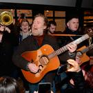 Glen Hansard, Hozier and other Irish musicians perform the annual charity Christmas Eve Busking session on Grafton Street in aid of homeless charities