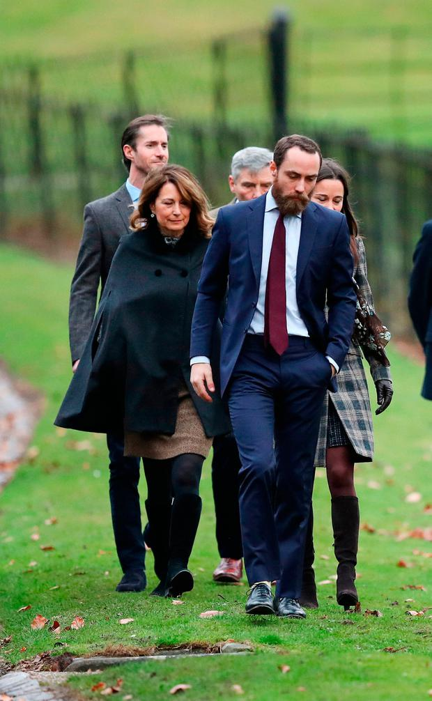 James Middleton (front), Pippa Middleton, Carole Middleton (left), James Matthews (back left) and Michael Middleton arrive to attend the morning Christmas Day service at St Mark's Church in Englefield, Berkshire.