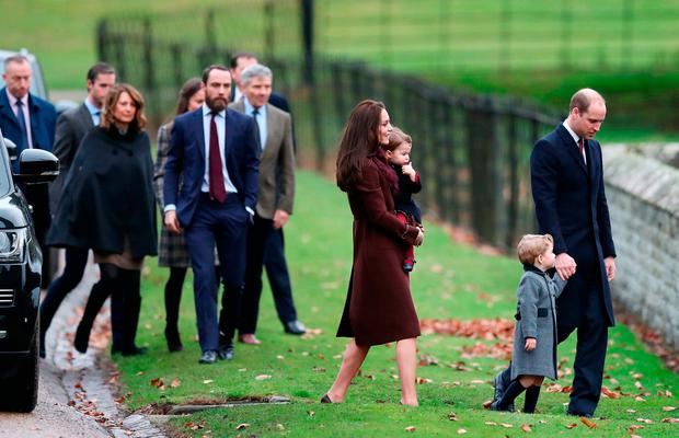 The Duke and Duchess of Cambridge (right), Prince George, Princess Charlotte followed by Carole, James and Michael Middleton arrive to attend the morning Christmas Day service at St Mark's Church in Englefield, Berkshire.