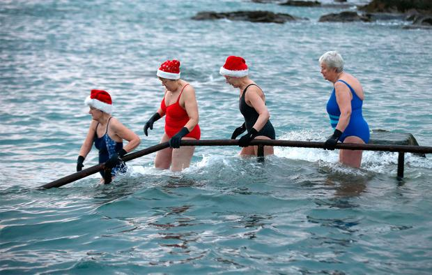 Christmas Day swimmers take the plunge at the 40 foot in Dublin Credit:Frank Mc Grath