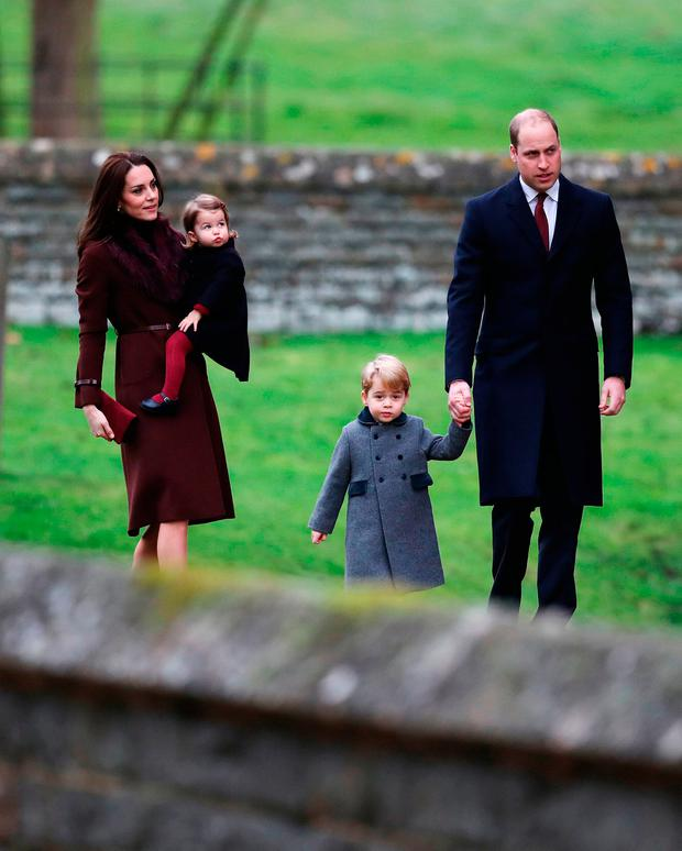 The Duke and Duchess of Cambridge, Prince George and Princess Charlotte arrive to attend the morning Christmas Day service at St Mark's Church in Englefield, Berkshire.