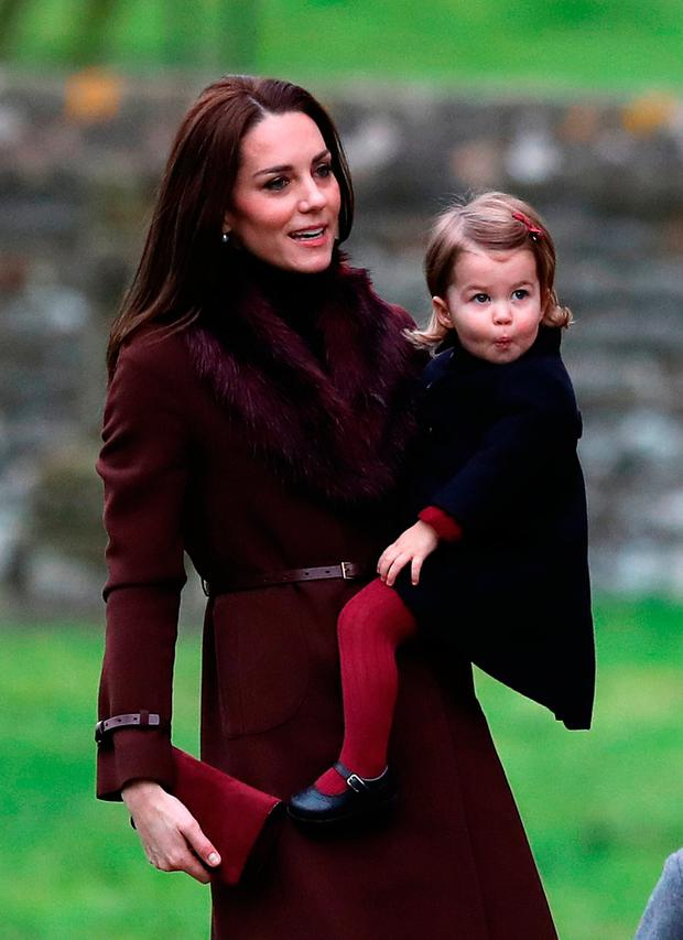 The Duchess of Cambridge and Princess Charlotte arrive to attend the morning Christmas Day service at St Mark's Church in Englefield, Berkshire.
