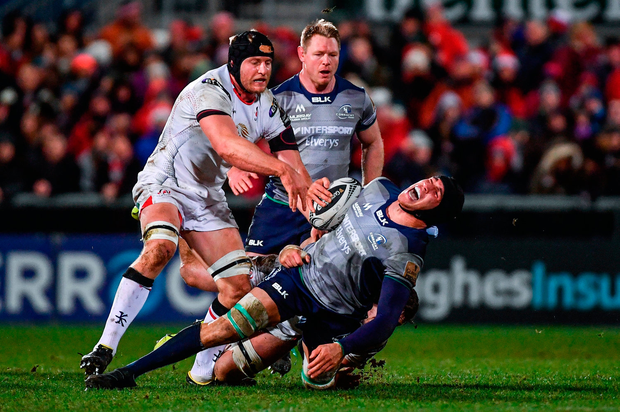 Ultan Dillane falls to the ground under pressure from Ulster's Sean Reidy. Photo by Ramsey Cardy/Sportsfile