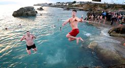 Swimmers take the plunge at the Forty Foot. Photo: Frank McGrath