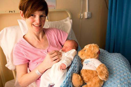 Carol Montgomery with her newborn Neil, who weighed 6lb 9oz when he arrived at the National Maternity Hospital in Holles Street at 12.18am. Photo: Mark Condren