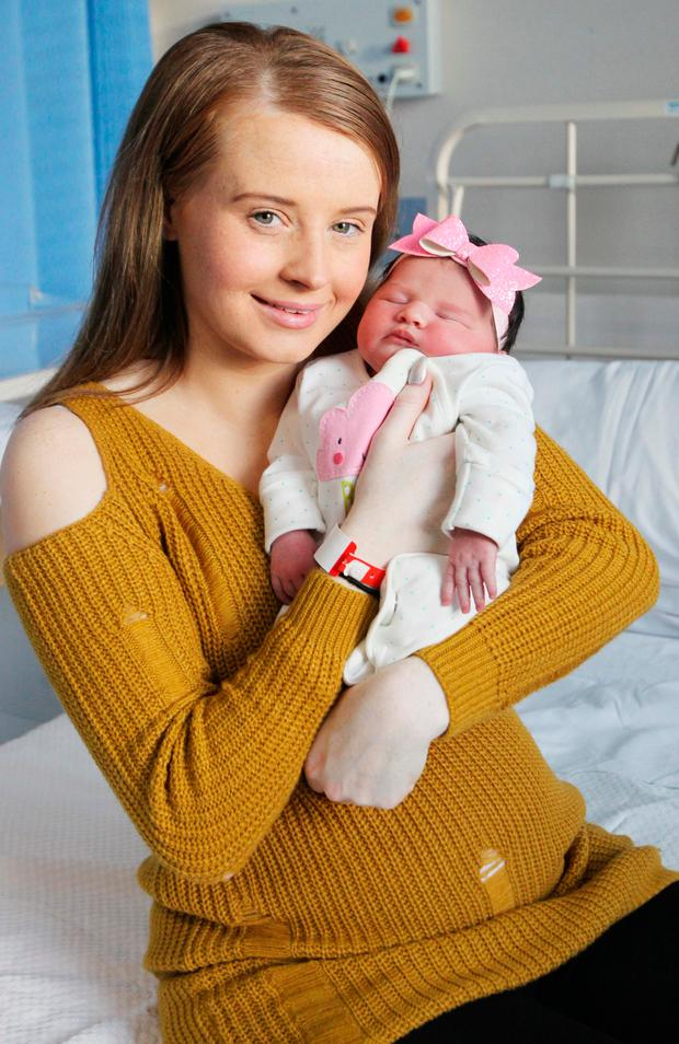 Jessica Coughlan with baby Lacey who was born at 02.03am in the Coombe and weighed 7lb 9oz. Photo: Stephen Collins/Collins Photos