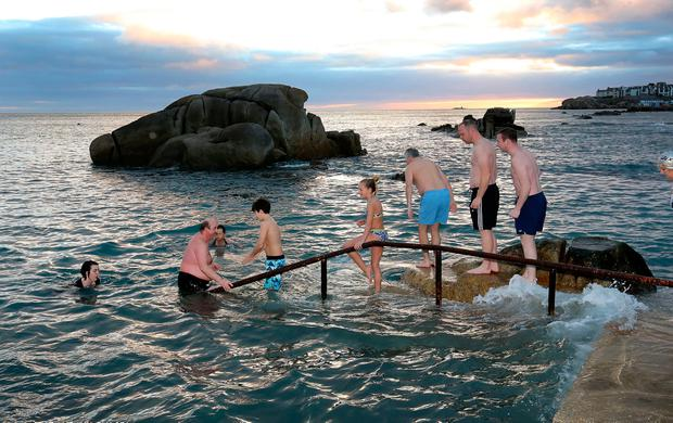 Christmas day swimmers take the plunge at the Forty foot in Dublin. Photo: Frank McGrath