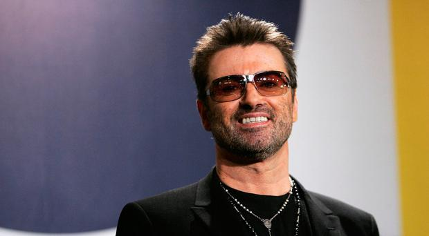 Singer George Michael poses at the