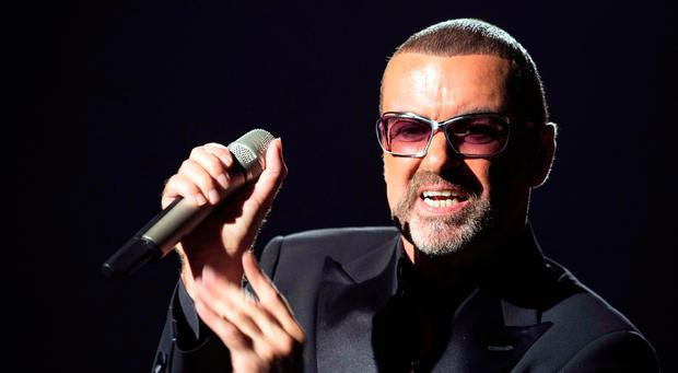 This file photo taken on September 9, 2012 shows British singer George Michael performing on stage during a charity gala for the benefit of Sidaction, at the Opera Garnier in Paris/ AFP PHOTO / MIGUEL MEDINAMIGUEL MEDINA/AFP/Getty Images