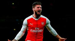 Olivier Giroud celebrates after scoring for Arsenal. Photo: Ian Kington/AFP/Getty Images