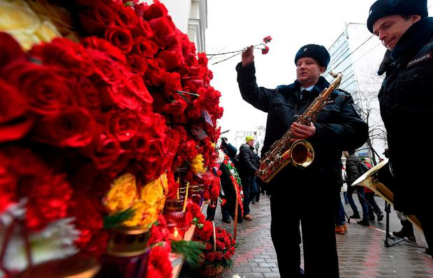 Russian police orchestra musicians pay tribute in front of the home stage building of the Alexandrov Ensemble (The Red Army Choir), in Moscow, yesterday. Photo: Natalia Kolesnikova/Getty Images