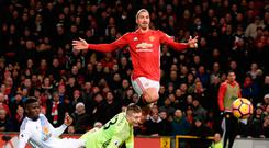 Zlatan Ibrahimovic lifts the ball over Sunderland keeper Jordan Pickford to score Manchester United's second goal. Photo: AFP/Getty