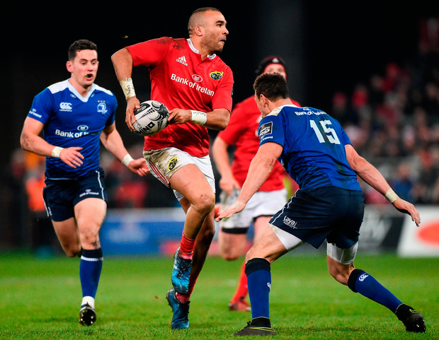 Leinster's Zane Kirchner lines up to tackle Munster's Simon Zebo. Photo: Sportsfile
