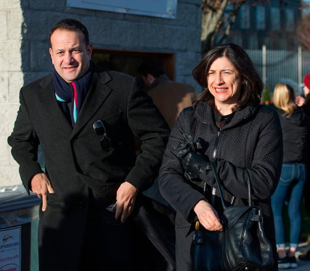 Social Protection Minister Leo Varadkar and his sister Sophie at the Leopardstown Christmas racing festival yesterday. Photo: Mark Condren