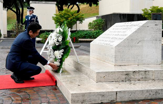 Japan's Prime Minister Shinzo Abe lays a wreath at the National Memorial Cemetery of the Pacific at Punchbowl in Honolulu. Photo: Hugh Gentry/Reuters