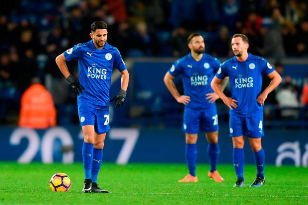 Riyad Mahrez (L) and teammates look dejected during the Premier League match between Leicester City and Everton at The King Power Stadium yesterday